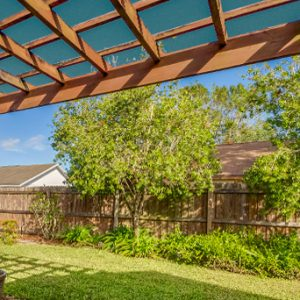 Pergola with shade sail attached